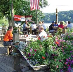 guests enjoying food outside at the Dock